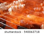 Small photo of sausage and meat on grill