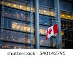 Canadian flag in front of a business building in Toronto, Ontario, Canada