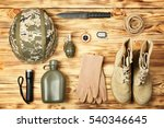 Military equipment on wooden...