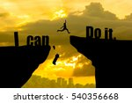 Small photo of Man jumping on I can do it or I can't do it text over cliff on sunset background,Business concept idea