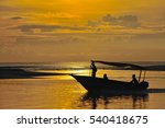 Boat With Fishermen In The Sea...
