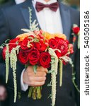 wedding bouquet with red roses | Shutterstock . vector #540505186