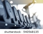 rows of dumbbells in the gym | Shutterstock . vector #540568135