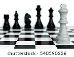 chessmen stand on a chessboard... | Shutterstock . vector #540590326