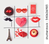 Small photo of Valentine's day background with heart shape and party accessories. Tic tac toe game concept. View from above. Flat lay