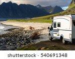 LOFOTEN, NORWAY - JUNE 29, 2015: Holiday trip in motorhome on June 29, 2015. Caravan car on coast. Beautiful nature Norway mountains landscape.  - stock photo