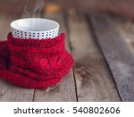 cup of hot tea wrapped in... | Shutterstock . vector #540802606