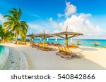 beach chairs with umbrella at... | Shutterstock . vector #540842866