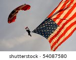A Sky Diver Carries An America...