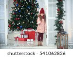 girl in a cap and scarf in warm ... | Shutterstock . vector #541062826