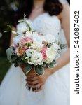 wedding flowers in hands | Shutterstock . vector #541087402