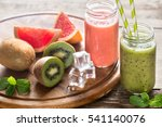 glass jars of fruit  smoothies   Shutterstock . vector #541140076