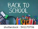school supplies on chalkboard... | Shutterstock . vector #541173736