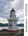 Small photo of Akaroa, New Zealand - February 21st, 2016 : The historical lighthouse in Akaroa.