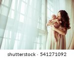 the mother hold of hands her son | Shutterstock . vector #541271092