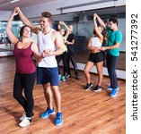 glad dancing couples learning... | Shutterstock . vector #541277392