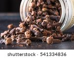 whole cloves spilling from a... | Shutterstock . vector #541334836