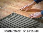 laying floor tiles on the... | Shutterstock . vector #541346338
