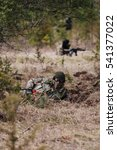 Small photo of HUMALA, ESTONIA - 09 APR 2016: Two soldiers in camouflage with weapons protect their position. Military tactical airsoft game.
