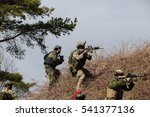 Small photo of HUMALA, ESTONIA - 09 APR 2016: Soldier in camouflage with weapon protect his position. Military tactical airsoft game.