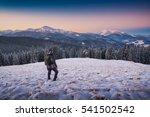 Hiker Standing On A Hill...