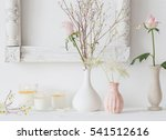 flowers in a vase and candles... | Shutterstock . vector #541512616