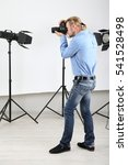 handsome photographer with... | Shutterstock . vector #541528498