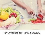 young happy woman cutting... | Shutterstock . vector #541580302