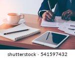businessman signing a document. ... | Shutterstock . vector #541597432