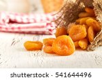 dried apricots on white rustic... | Shutterstock . vector #541644496