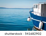 A Blue Fishing Boat In The Sea ...