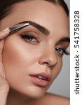 eyebrow correction. closeup of...   Shutterstock . vector #541758328
