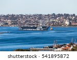 Small photo of San Diego, USA. 19th December, 2016. The United States aircraft carrier USS Theodore Roosevelt (CVN 71) departs Naval Air Station North Island in San Diego, USA.