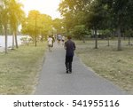 Many People Jogging In The Par...