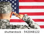 Male army soldier on American flag background - stock photo
