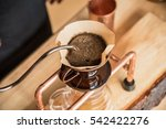 barista pouring water on coffee ... | Shutterstock . vector #542422276