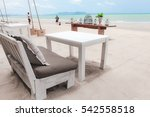 Sofa And Table On The Beach In...