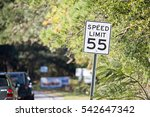 "white sign with ""speed limit 55""... 