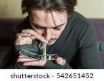 addict man smells cocaine from... | Shutterstock . vector #542651452