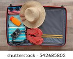 open suitcase packed for... | Shutterstock . vector #542685802