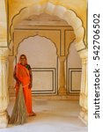 Small photo of AMBER, INDIA - NOVEMBER 13: Unidentified woman stands in Sattais Katcheri Hall in Amber Fort on November 13, 2014 in Amber, India. Amber Fort is the main tourist attraction in the Jaipur area.