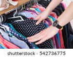 clothes hanging on the rack in... | Shutterstock . vector #542736775