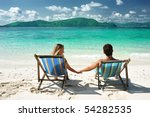 Couple On A Tropical Beach In...