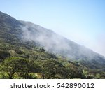 mountain in fog | Shutterstock . vector #542890012