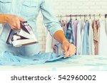 closeup of woman ironing... | Shutterstock . vector #542960002