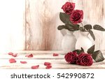 Stock photo home decor red rose flowers in a vase vintage photo retro interior with flowers 542990872