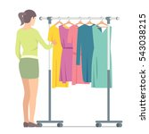 woman near rack with clothes....   Shutterstock .eps vector #543038215
