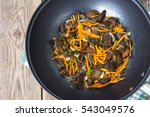 Mushrooms Fried With Onions An...