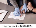 Police Takes Fingerprints Of A...