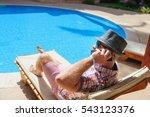 man in hat sunbathing on the... | Shutterstock . vector #543123376